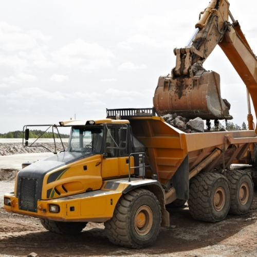 excavator-loading-dump-truck-at-construction-site.jpg